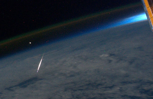 in 2011 astronaut Ron Garan got a photo of a Perseid meteor burning up in the air below him.